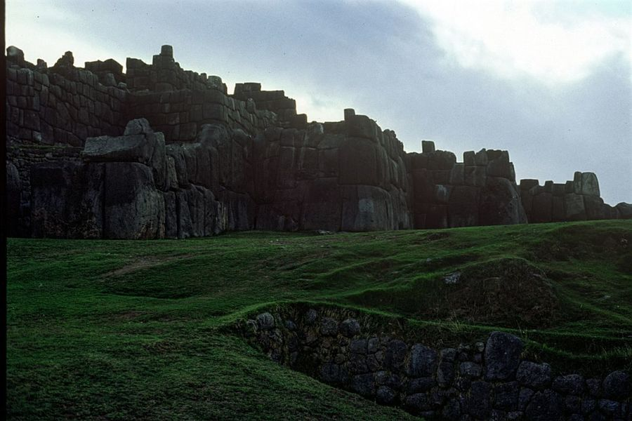 Miles Away Peru Sacsayhuaman Backlight Ancient Civilization Incas Archeological Site Old Stones Tourism Travel Destinations Landscape Outdoors Sky Grass Green Grass Green Color Cloudy Day