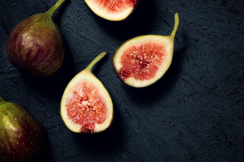 Close-up of sliced fruits against black background