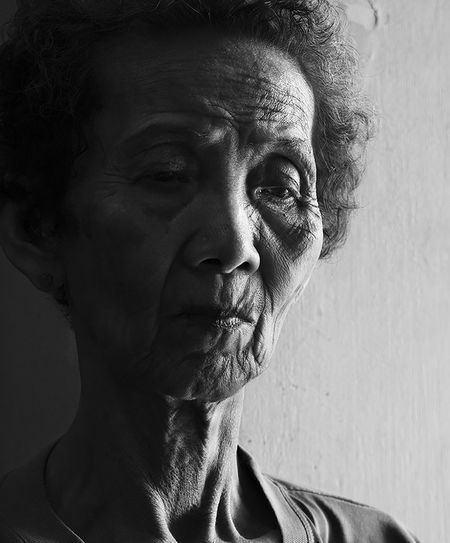Widow My Hero Black&white Blackandwhite Close-up Contemplation Day Elderly Elderly Woman Headshot Human Face Indoors  Mature Adult Mother One Person People Portrait Portrait Of A Woman Portraits Portraiture; B/W Photography Real People Senior Adult Serious Widow The Portraitist - 2017 EyeEm Awards Black And White Friday