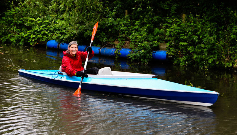 Kayak 1 Adult Adventure Day Holding Kayak Lake Leisure Activity Mature Woman Men Mode Of Transportation Nature Nautical Vessel Oar One Person Outdoors Plant Real People Red Jumper Senior Senior Women Transportation Tree Water