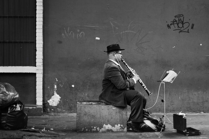 Playing Blackandwhite Urban City Life One Man Only Black And White Men Music Artist Musical Instrument People Arts Culture And Entertainment Real People Sitting Musician City Architecture Full Length Clothing Day Outdoors Adult Street Creativity Cap Social Issues Graffiti Adult Wall - Building Feature The Street Photographer - 2018 EyeEm Awards