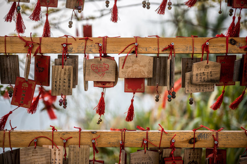 Messages people hang to a wood structure in order to bring good luck Abundance ASIA Asian Culture Bouddhisme China Chinese Culture Close-up Cultures Focus On Foreground Hanging Hope Hope - Concept Large Group Of Objects Lock Luck No People Outdoors Place Of Worship Protection Red Religion Spirituality Text Wood - Material EyeEmNewHere