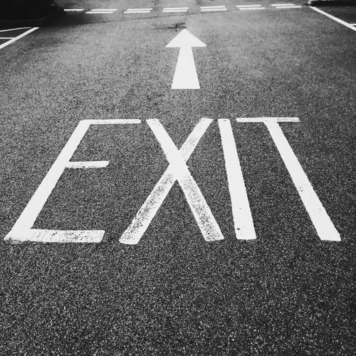 High angle view of exit sign on road