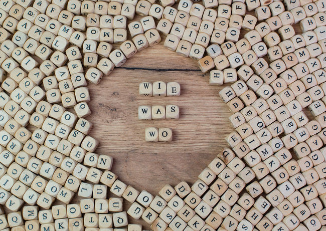 Wie was wo, German text for How what where, word in letters on cube dices on table Cube Finding Learning Letters Text What Wooden Table Word Concept Flat Lay How Information Instructions Intelligence Keyword Knowing Knowledge Label Macro Questioning Understanding When Where