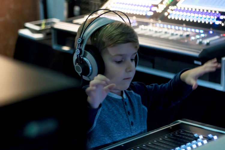 Technology Childhood One Person Music Child Arts Culture And Entertainment Sound Recording Equipment Audio Equipment Innocence Boys Headphones Sound Mixer Listening Dj Club Dj