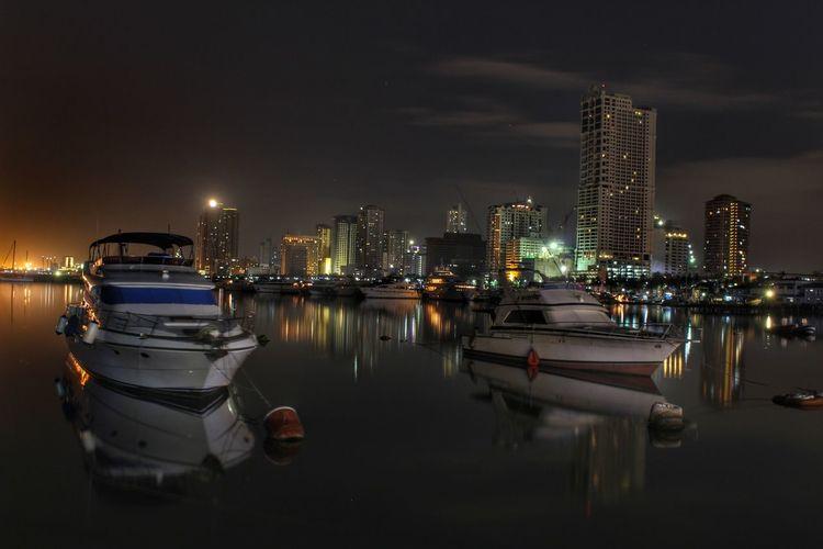 Panoramic view of illuminated city at night