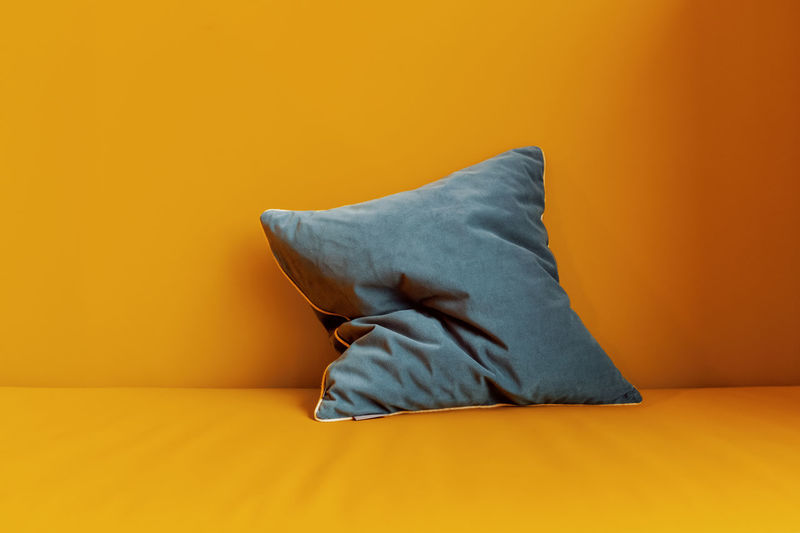 Best Place No People Indoors  Yellow Orange Color Colored Background Textile Furniture Domestic Room Comfortable Relaxation Wall - Building Feature Bed Home Interior Pillow Blanket Linen Single Object Lifestyles Cozy Orange Background Bold Colors 2018 In One Photograph Moments Of Happiness
