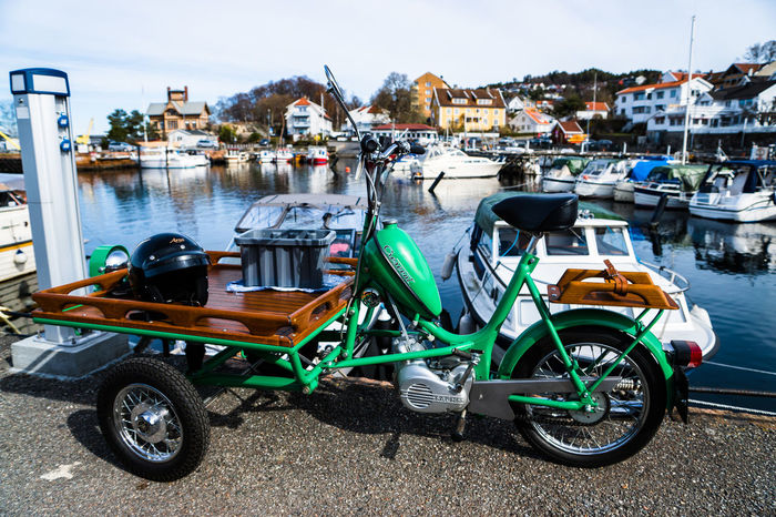 Architecture Bicycle Boat Building Exterior Built Structure Canal City Day Drøbak Harbor Land Vehicle Mode Of Transport Moored Nautical Vessel Norway Parked Parking Residential Building Residential Structure Stationary Street Transportation Travel Traveling Water