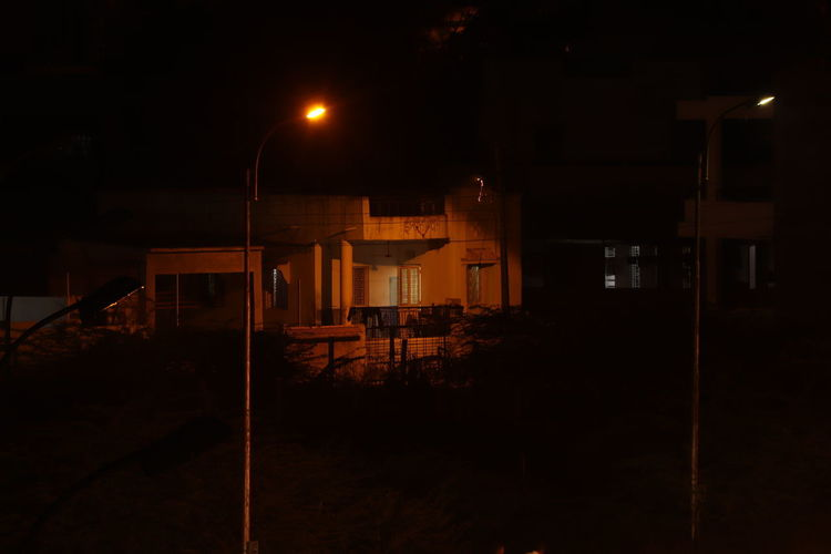 Night View Wide Angle View Top View Cityscape Bunglow Illuminated Spooky Sky Building Exterior Gate Closed Door Entrance Barbed Wire Urban Scene Open Door