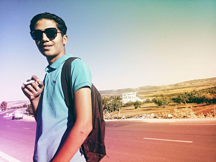 EyeEm Selects Canon Sunglasses Young Adult Portrait Looking At Camera Adult People One Man Only One Person Adults Only One Young Man Only Sky Cool Attitude Men Only Men Youth Culture Desert Outdoors Beach Sport Day Canonphotography Lovecanon Canon Photography Be. Ready. EyeEmNewHere