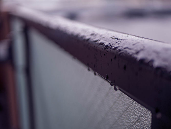 Close-up of old pipe on railing