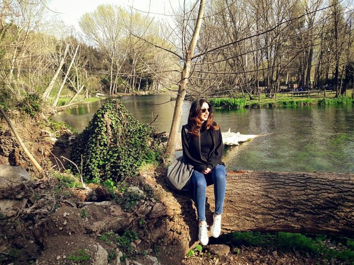 Tree Portable Information Device Full Length Smart Phone Nature One Person Casual Clothing Wireless Technology Leisure Activity Mobile Phone Young Adult One Woman Only Front View Portrait Outdoors Forest Day Technology People Only Women