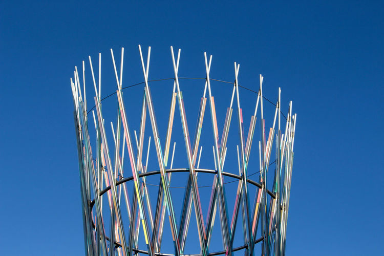 Low angle view of basketball hoop against clear blue sky