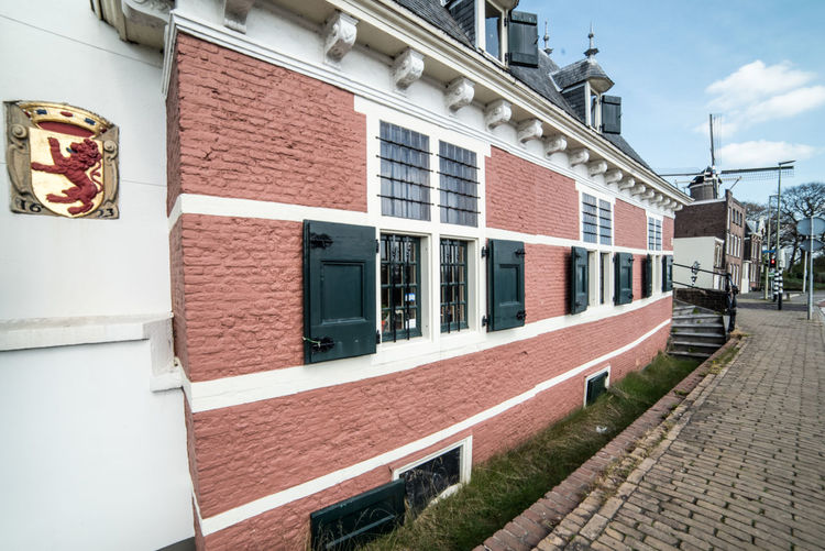 Monumental building Building Exterior Architecture Built Structure Building City Day Window Footpath No People Street Sidewalk Residential District Outdoors Brick Nature Sky Wall Brick Wall Red House Row House