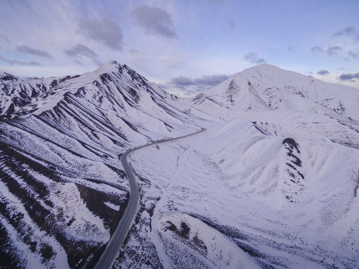 Drone  Arid Climate Beauty In Nature Cloud - Sky Cold Temperature Covering Day Dronephotography Environment Landscape Mountain Mountain Range Nature No People Non-urban Scene Outdoors Scenics - Nature Sky Snow Snowcapped Mountain Tranquil Scene Tranquility White Color Winter