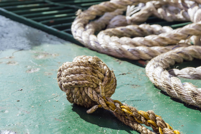 Monkey fist Rope Water Strength Close-up Tied Up Transportation No People Nautical Vessel Focus On Foreground Day Tied Knot Outdoors Connection Nature Metal Mode Of Transportation Moored Safety Sea Tangled Monkey Fist Knot