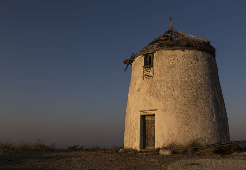 One of many windmills on island Paros, Greece 16mm Agriculture City Lonely Low Angle View Nature Paros Pure Tranquility Windmill Abandoned Architecture Clear Sky Country Life Countryside Evening History Landscape Lefkes Minimal Reet Round Sun Sunset Wide Angle