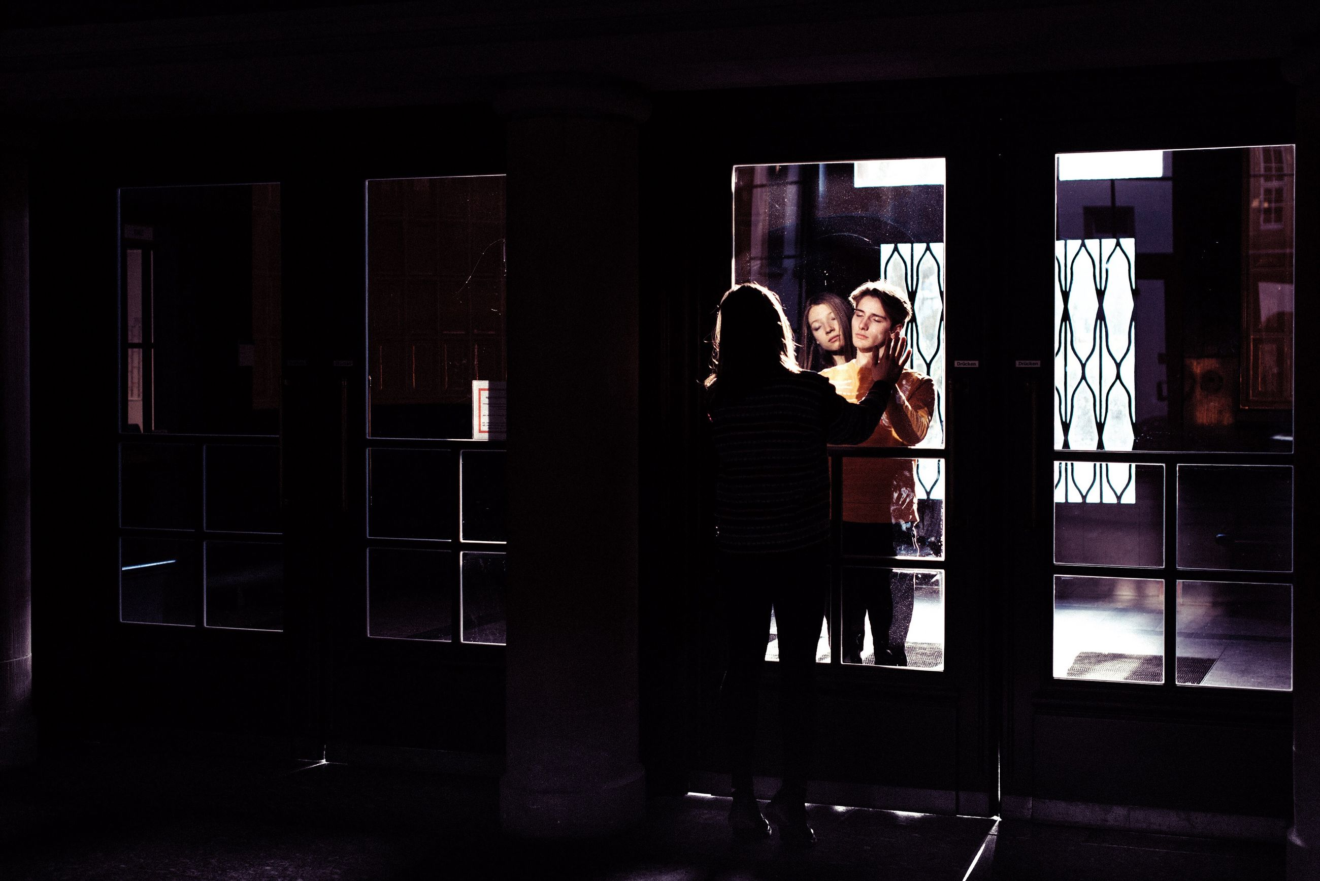two people, window, real people, full length, adult, lifestyles, adults only, people, leisure activity, night, standing, men, women, indoors, togetherness, young adult