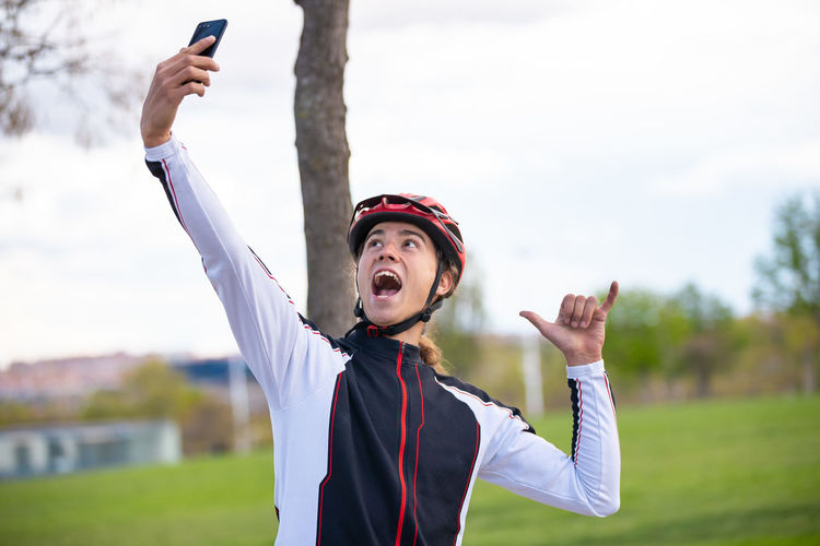 Male athlete taking selfie while standing park