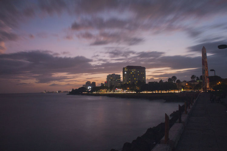 #yimelriveraphotography Nature Photography Santo Domingo, DR Architecture Building Exterior Built Structure Cielo Y Nubes  City Cityscape Cloud - Sky Illuminated Larga Exposicion Modern Natgeo Natgeo Adventure Natgeotravel Night No People Outdoors Photography Republicadominicana Sky Skyscraper Sunset Travel Destinations Urban Skyline