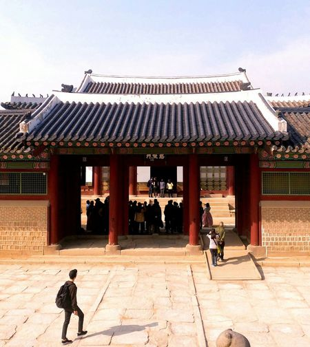 Building Exterior Built Structure Architecture Sunlight Outdoors Real People Day Roof People One Person Adult Adults Only Solar Panel Only Men Korean Traditional Architecture Architecture Korean Culture Korean Loyalpalace