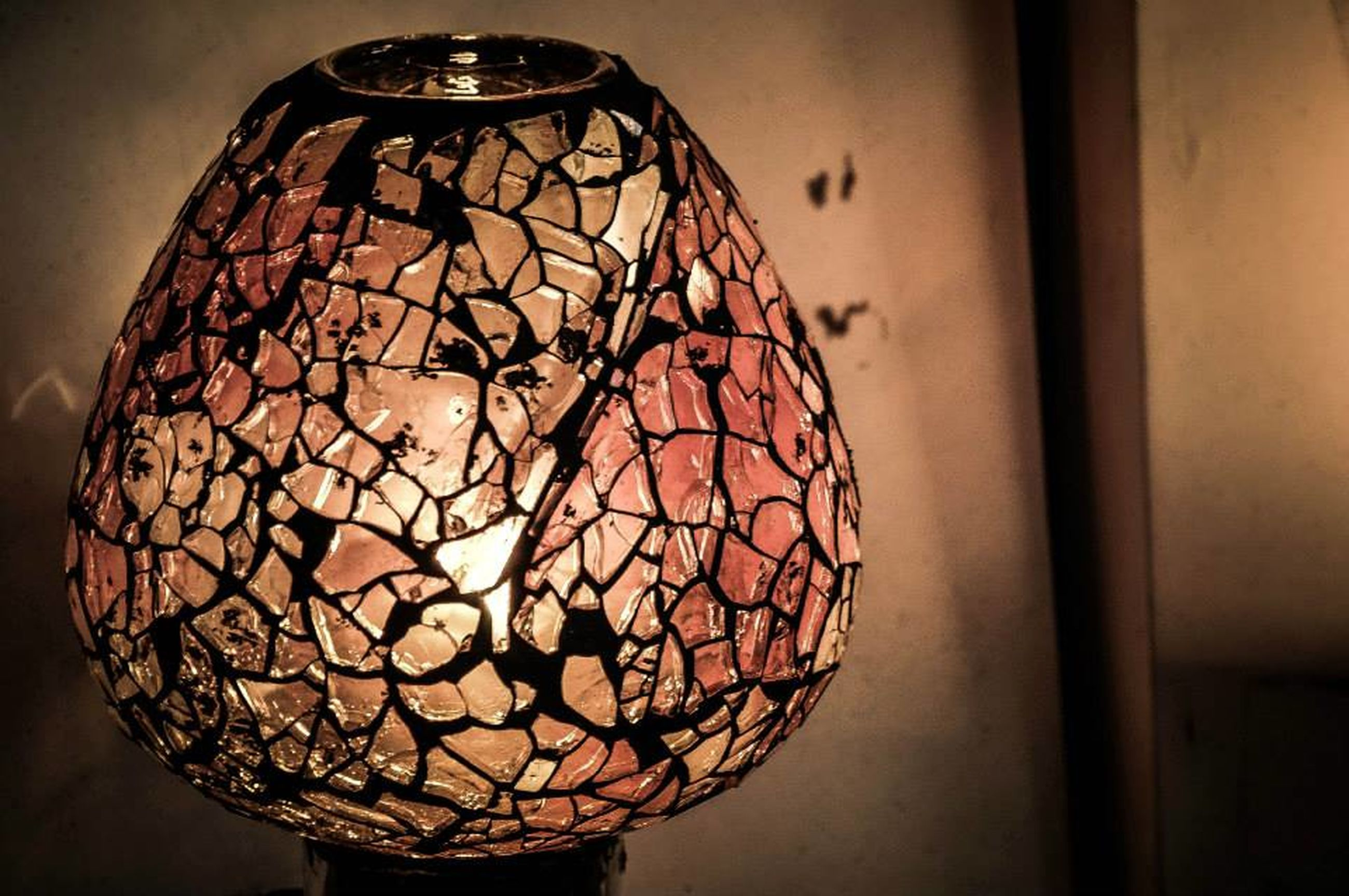 indoors, illuminated, lighting equipment, close-up, decoration, hanging, art and craft, art, home interior, creativity, electricity, wall - building feature, low angle view, design, still life, electric lamp, lantern, decor, light bulb, no people