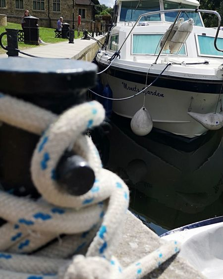 Ropes Boats Rope Knot Focus On Background Nautical Vessel City Harbor Moored Close-up