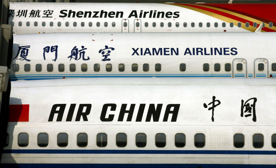 Air China Aircraft Airlines Airplane Chengdu China Chinese Chinese Writing Day Lines Lines And Shapes No People Shenzhen Text Window Windows Xiamen Beautifully Organized
