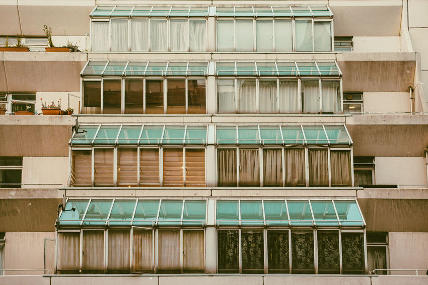 Air Conditioner Apartment Architecture Backgrounds Balcony Building Building Exterior Built Structure City Day Full Frame Glass - Material Low Angle View Modern No People Outdoors Repetition Residential District Side By Side Window