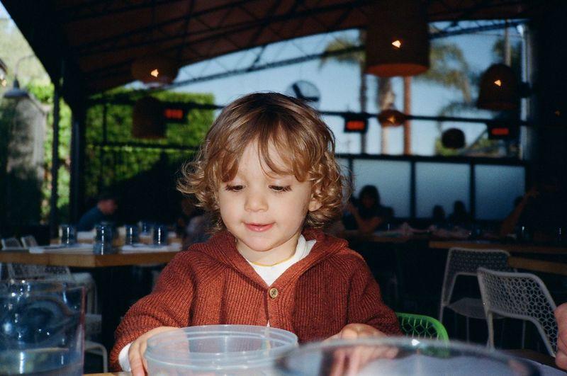 Portrait of boy looking away in restaurant