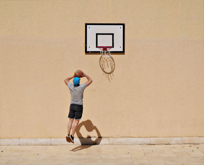 The Street Photographer - 2017 EyeEm Awards t Photographer - 2017 EyeEm Awards activity Adult Adults Only Aiming Ball Basketball - Sport Basketball Hoop Basketball Player Court Day Exercising Full Length High Wall Lifestyles Men One Person Outdoors People Playing Reflections On The Wall Scoring Sport Young Adult Live For The Story Paint The Town Yellow