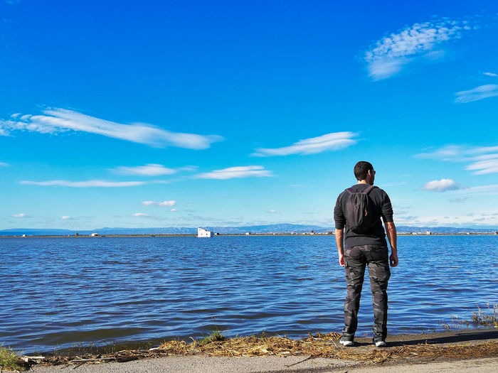 Water Sea Sky Full Length One Person Rear View Real People Beach Standing Scenics - Nature Land Beauty In Nature Lifestyles Men Casual Clothing Leisure Activity Day Cloud - Sky Non-urban Scene Horizon Over Water Outdoors Man Fields Rice