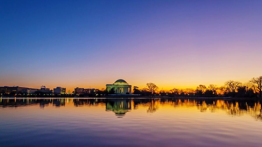 Jefferson Memorial Reflecting On Calm Lake Against Clear Sky During Sunset