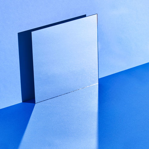 Low angle view of paper against blue sky