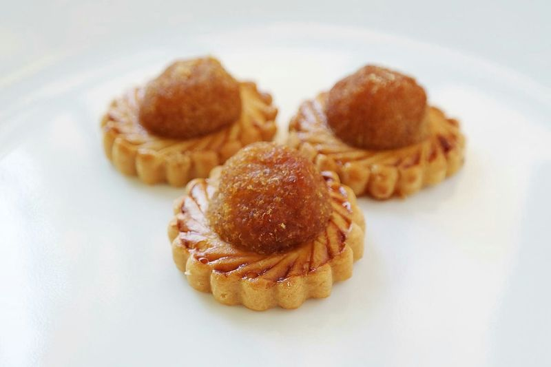 Close-Up Of Pineapple Tarts On Plate