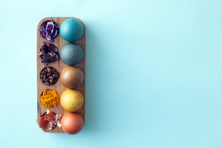 High angle view of multi colored candies against blue background