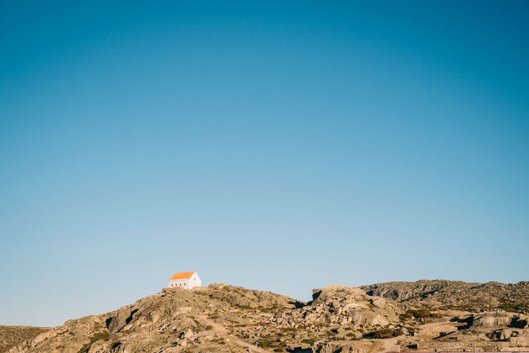 Architecture Beauty In Nature Blue Building Exterior Built Structure Clear Sky Day Geology Low Angle View Manteigas Mountain Nature No People Outdoors Physical Geography Rock - Object Scenics Sky Tranquility Travel Destinations