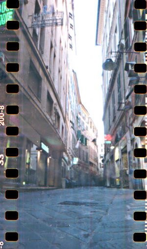 Alleys of Genova. The picture is realized with an home made pinhole camera. 6 minutes of exposure. 35mm Film Alleys Analogue Photography Architecture Artistic Blurry Building Building Exterior Built Structure City City Life Diminishing Perspective Exterior Film Genova Homemade Camera Italy Kodak Colorplus Modern No People Outdoors Pinhole Pinhole Camera Pinhole Photography Street