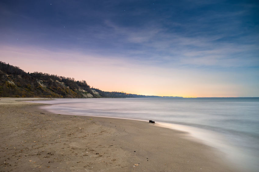Beach Sea Night Sand Sky Landscape Summer Travel Destinations Toronto Tranquility Tranquil Scene Dusk No People Cloud - Sky Horizon Over Water Low Tide Blue Outdoors Backgrounds Night Photography Moonlight Moonlightscape Long Exposure Bright Night Lake