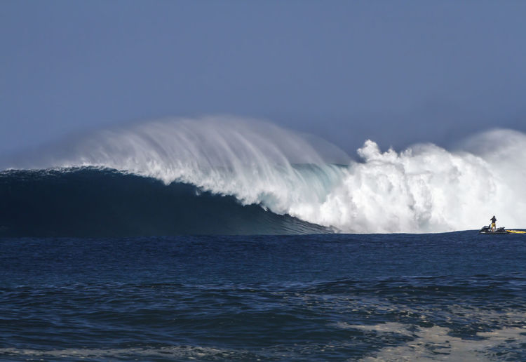 A Giant breaking wave on the north shore of Oahu Big Waves Blue Wave Hawaii North Shore Oahu Spraying Beauty In Nature Clear Sky Day Giant Waves Horizon Over Water Motion Nature Ocean Outdoors Power In Nature Scenics Sea Sky Surfing Tow Surfing Water Waterfront Wave Wave Runner Wind