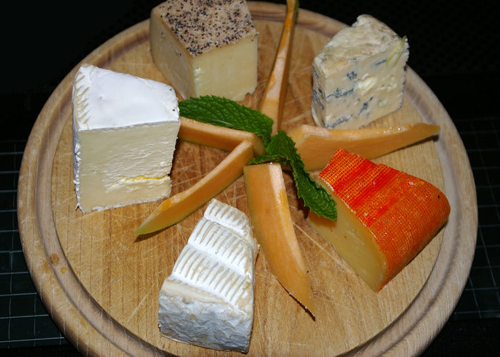 Cheeseboard with a variety of cheeses and slices of cantaloupe Food And Drink Food Healthy Eating Freshness Still Life Wellbeing Indoors  High Angle View Close-up Ready-to-eat SLICE Fruit Cheese No People Dairy Product Directly Above Table Indulgence Temptation Cheese! Board