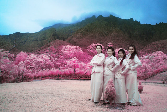An infrared view of a group of young girls at the base of Mount Kinabalu. Happiness Infrared Student Teamwork Cold Color Infrared Colorful Foliage Day Full Length Infrared 690nm Infrared Photography Looking At Camera Mountain Mountain Range Nature Outdoors People Portrait Real People Sky Smiling Togetherness Tree Young Adult Young Women