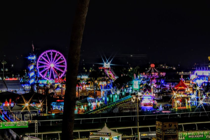 It's not the fair without sketchy rides and greasy food Night Amusement Park Illuminated Ferris Wheel Amusement Park Ride Multi Colored No People Outdoors Big Wheel Architecture Sky Arts Culture And Entertainment Glowing Long Exposure