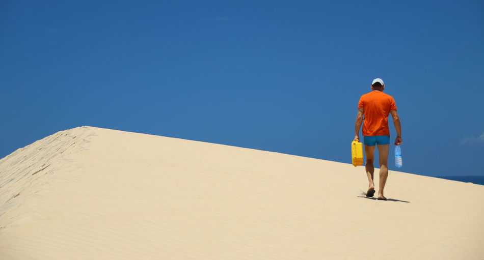 Adventure Blue Sky Clear Sky Cloudless Sky Landscape One Man Only Sand Sand Dune Walking