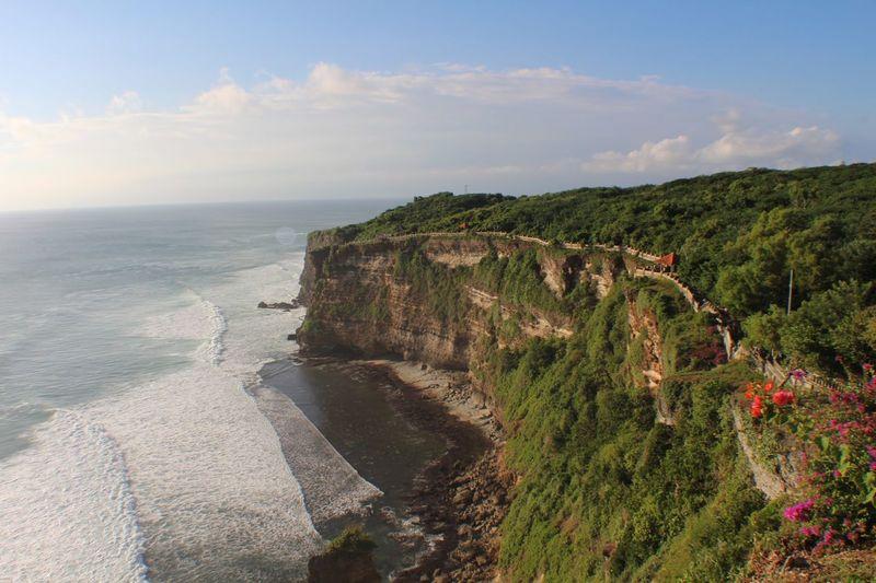 Scenic view of sea and cliff at uluwatu beach