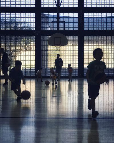 Indoors  Real People Silhouette Day Lifestyles Basketball - Sport Architecture Full Length City People