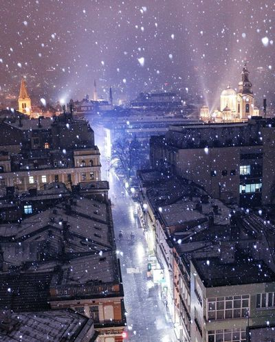 Snowing Illuminated Architecture Cityscape City Night Above Snow Flakes ❄ Falling Snowflakes Winterwonderland Winter Christmas Is Coming Sarajevo Churches Sarajevo Streetphoto Skyscraper Building Exterior Urban Skyline Star - Space City Life Sky Downtown District Built Structure Modern Outdoors