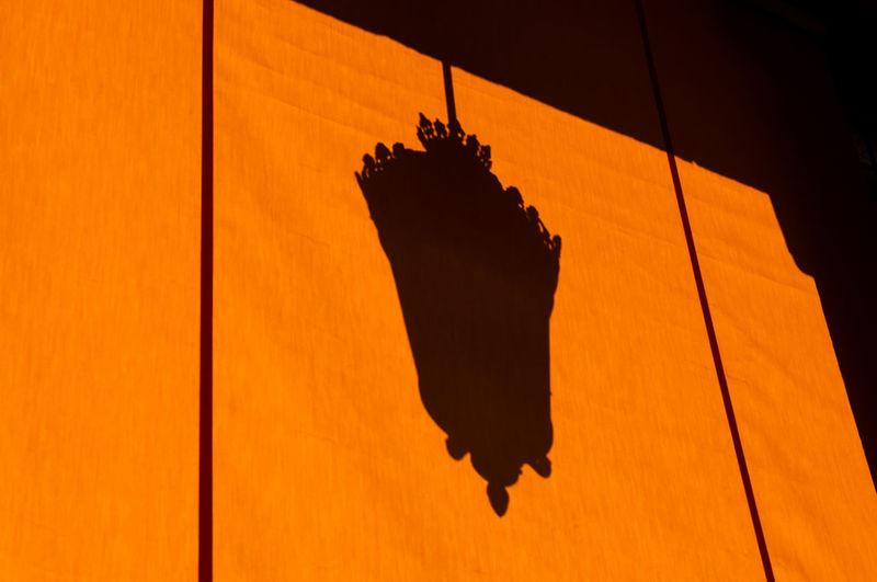 Shadow of street light on orange awning