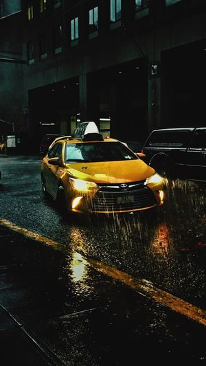 Yellowcab Perfect Shot Perfect IPhone Photography EyeEmNewHere EyeEm Best Shots Taxi New York Driver Cabdriver Cab Mode Of Transportation Transportation Car Motor Vehicle Night Architecture City Building Exterior Water Street Yellow Yellow Taxi Wet No People