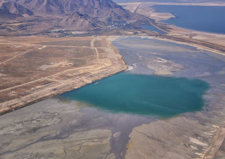 High angle view of lake amidst landscape